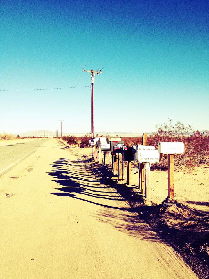 mailbox-shadows,-sunset-road