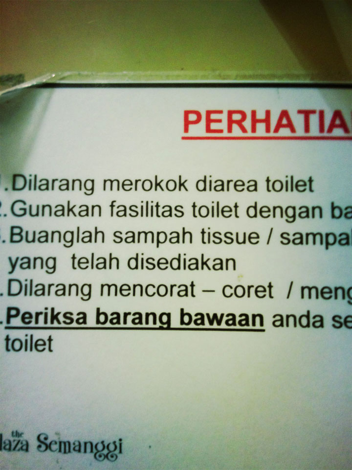 Sign-on-back-of-toilet-door.-Jakarta