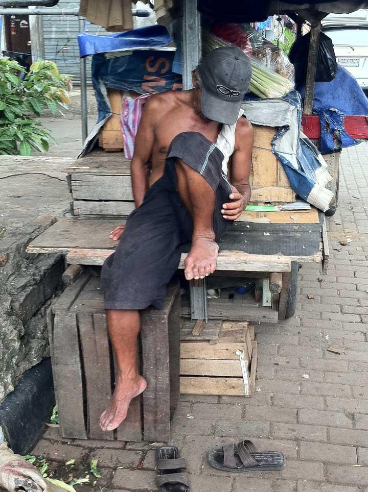 Sleeping man on the street.