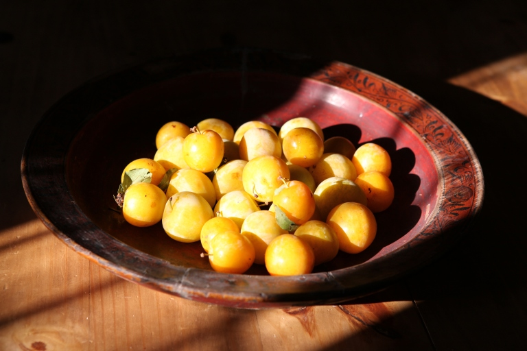 Yellow plums in